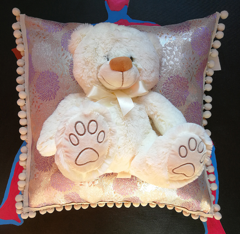 original decorative pillow with a fluffy teddy bear